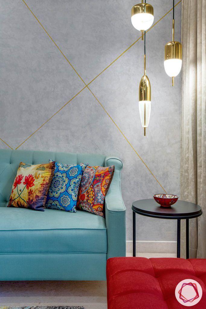 best interior designers in gurgaon-blue sofa designs-round side table designs-pendant light for corner