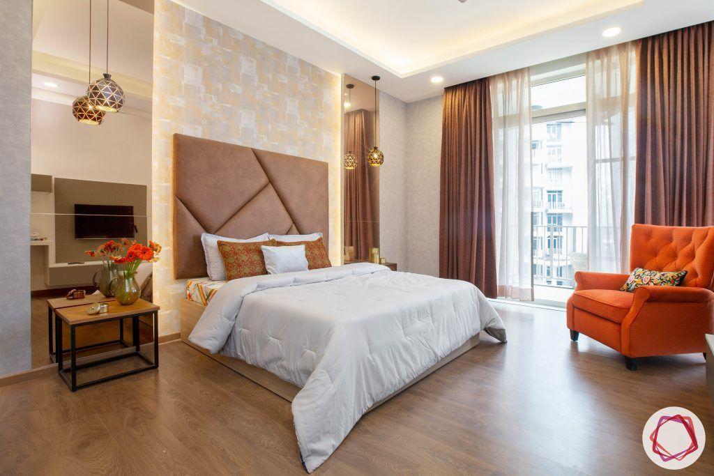 best interior designers in gurgaon-contemporary bedroom designs-orange armchair designs-tinted mirror panels