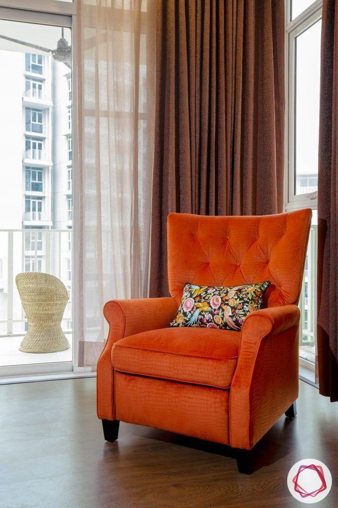best interior designers in gurgaon-orange armchair designs-wooden flooring ideas
