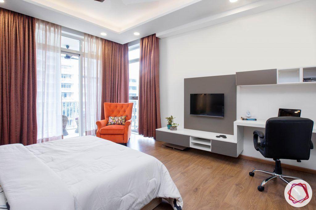best interior designers in gurgaon-media wall for bedroom-orange armchair designs