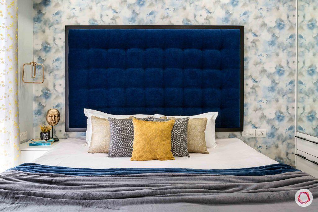 livspace interior-bedroom-headboard-blue-wallpaper-pillows