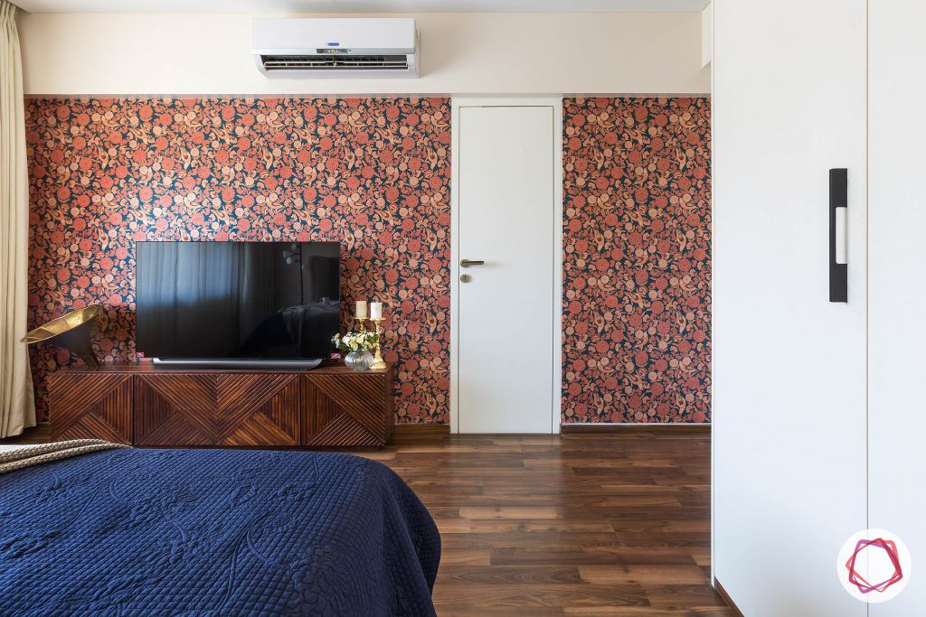 floral wallpaper-wooden tv unit-storage