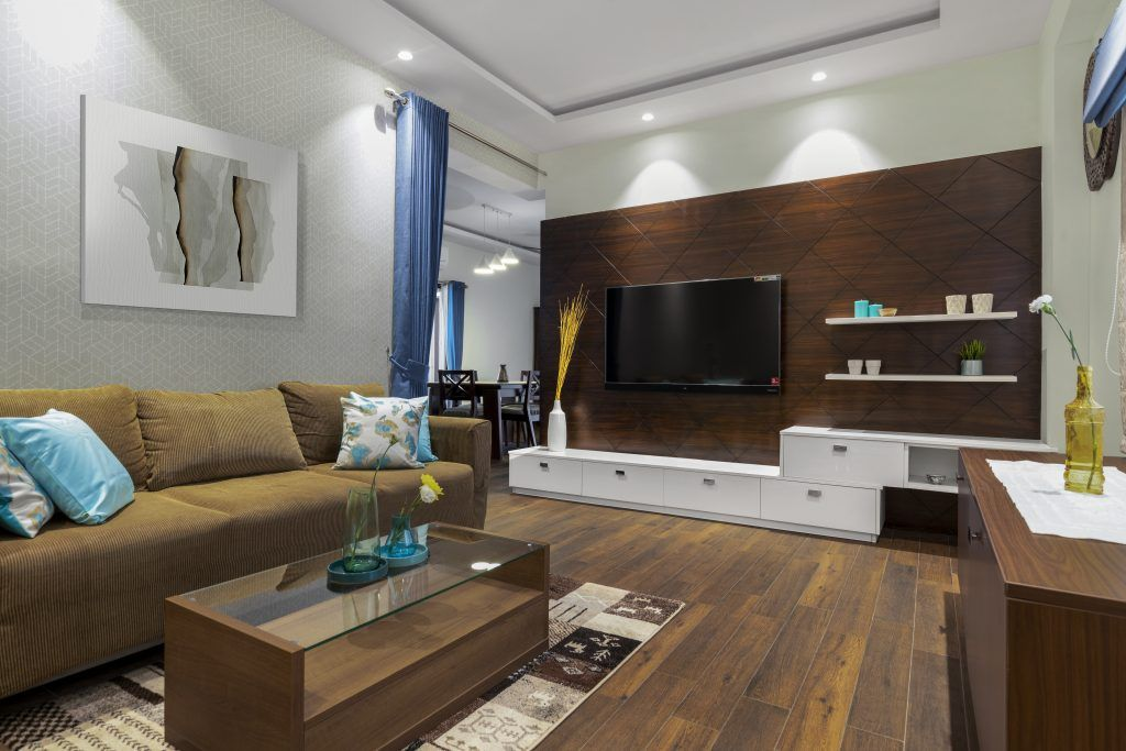 chocolate-panel-false-ceiling-sofas-white-shelves-blue-curtains