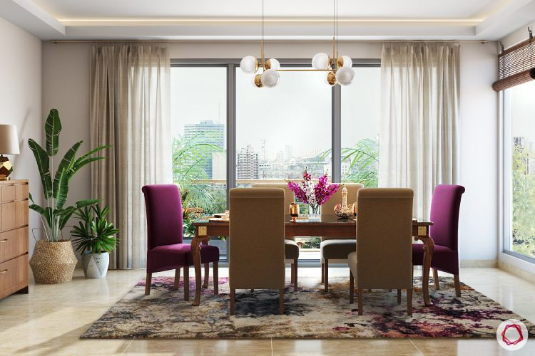 twinkle khanna interior-dining-room-upholstered-chairs-light-rug-plant-buffet-table-painting