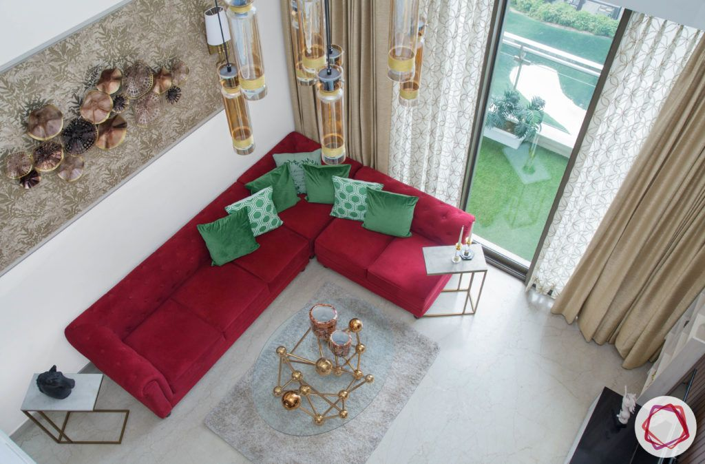 basic vastu for home-aerial view of room-living room-red sofa-chandelier-centre table