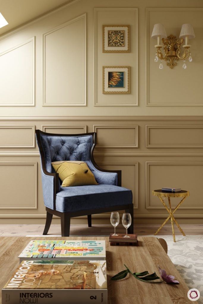 celebrity-homes-accent-blue-chair-trims-wall-table-wood-glasses-magazines