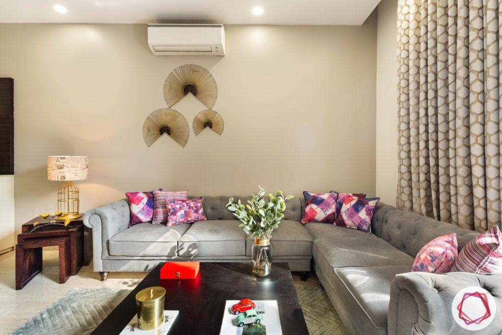 DLF garden villas-living-room-grey-l-shaped-sofa-table-pillows