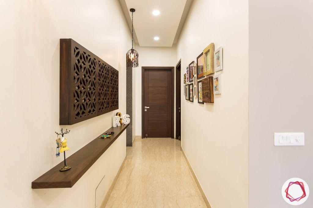 DLF garden villas-foyer-wood-light-shelf-false-ceiling