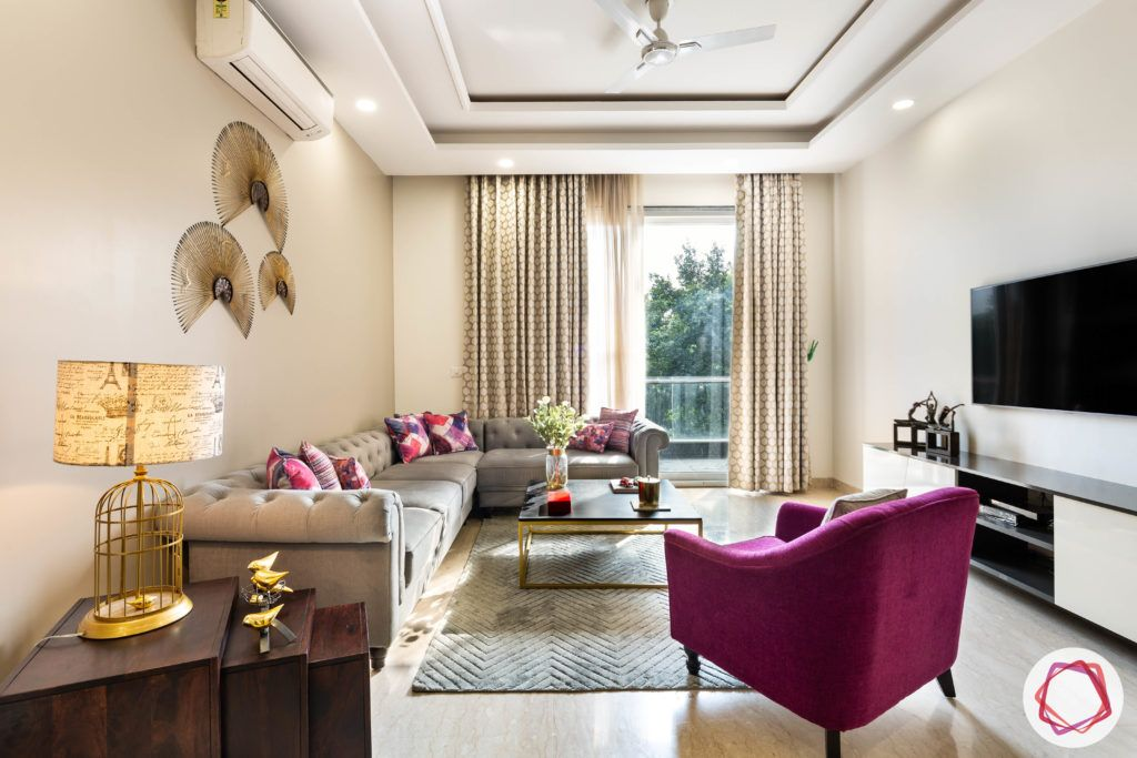 DLF garden villas-living-room-false-ceiling-sofa-table-TV-balcony