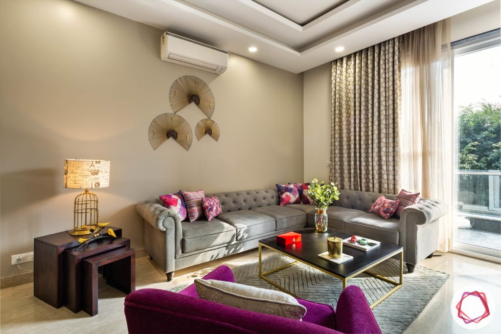 DLF garden villas-living-room-false-ceiling-sofa-table-TV-balcony-lamp