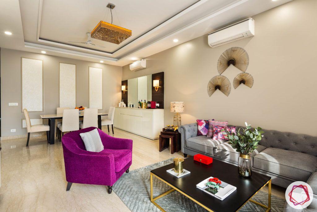 DLF garden villas-living-room-false-ceiling-sofa-table-TV-balcony-magenta-armchair