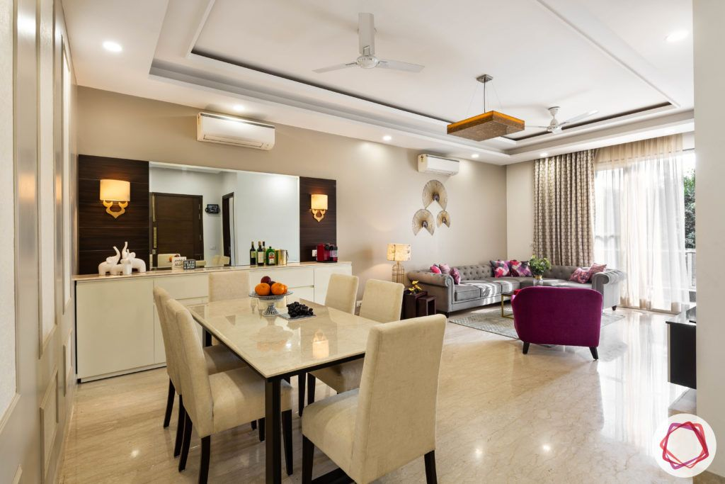 DLF garden villas-dining-room-marble-table-suede-chairs