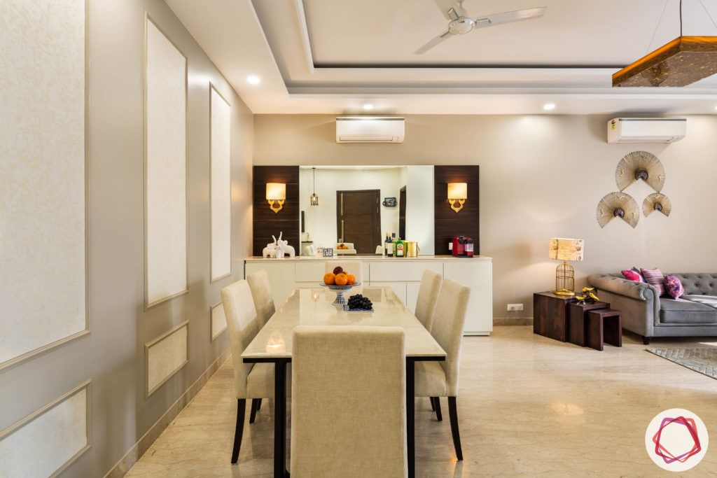 DLF garden villas-dining-room-marble-table-suede-chairs-crockery-cabinet