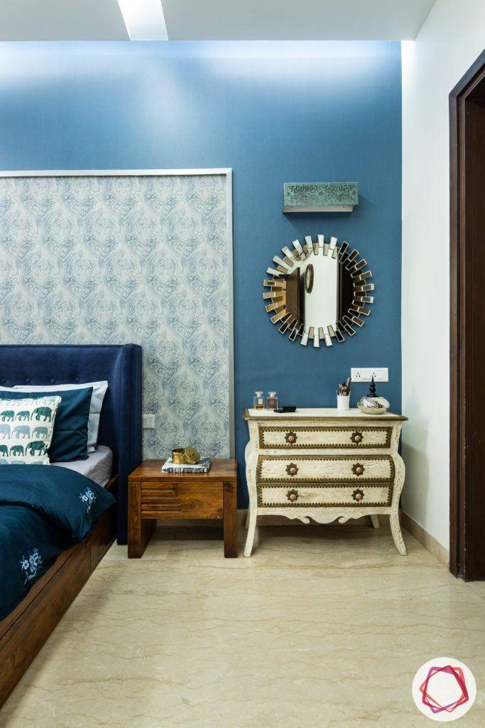 blue-wall-sheet-headboard-side-table-mirror