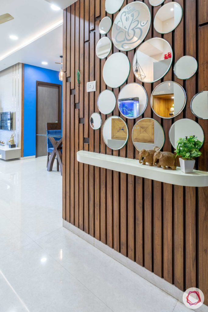 2 bhk flat interior-entrance-foyer-mirrors-wooden panels