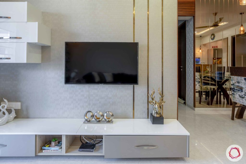 2 bhk flat interior-living room-tv unit-texture wallpaper-acrylic finish cabinets