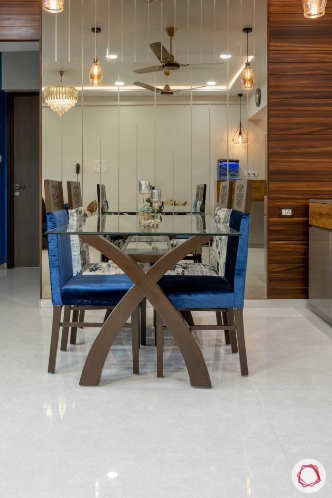 2 bhk flat interior-dining room-mirror panels-glass top table-upholstered chairs