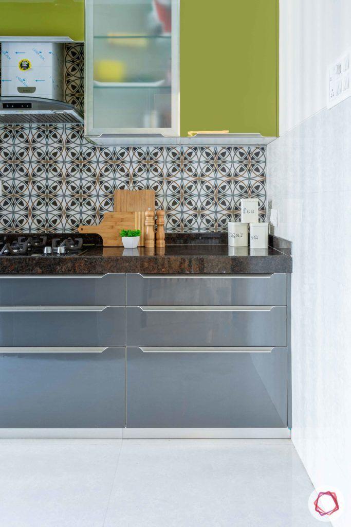 2 bhk flat interior-kitchen-green cabinets-glossy acrylic finish-grey base units-moroccan tiles