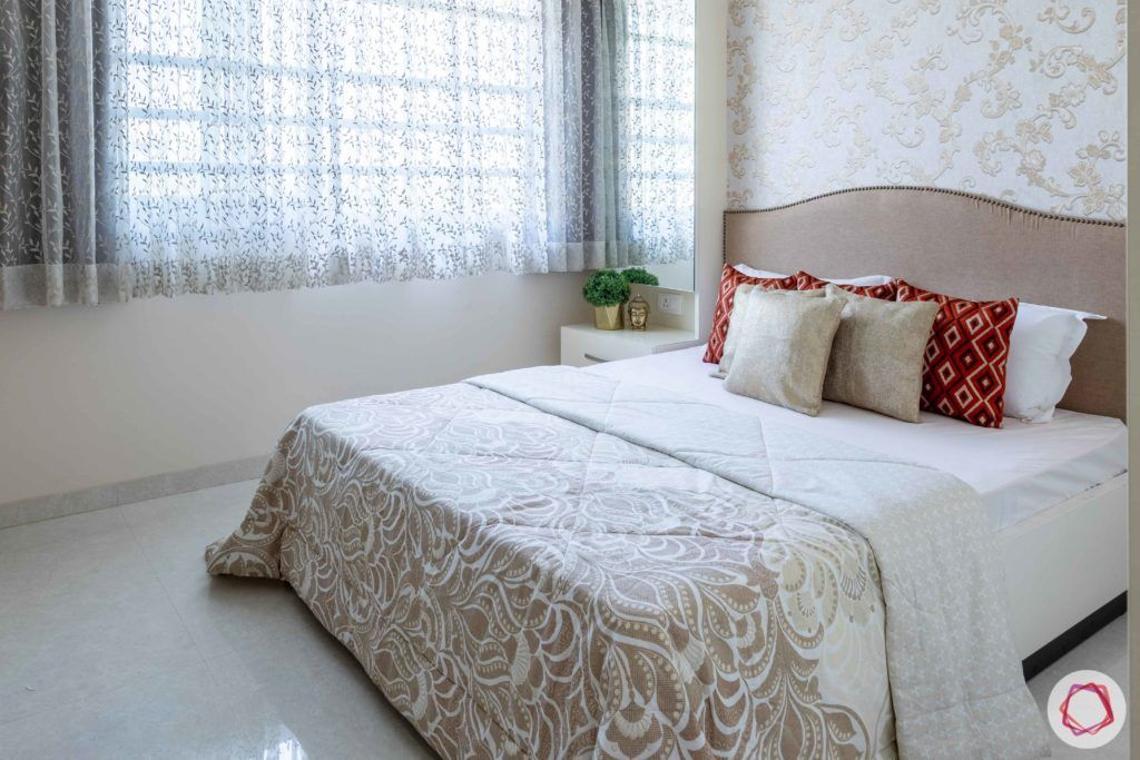 2 bhk flat interior-guest bedroom-printed wallpaper-white bed