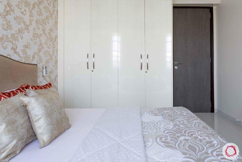 2 bhk flat interior-guest bedroom-white swing door wardrobe-laminate wardrobe