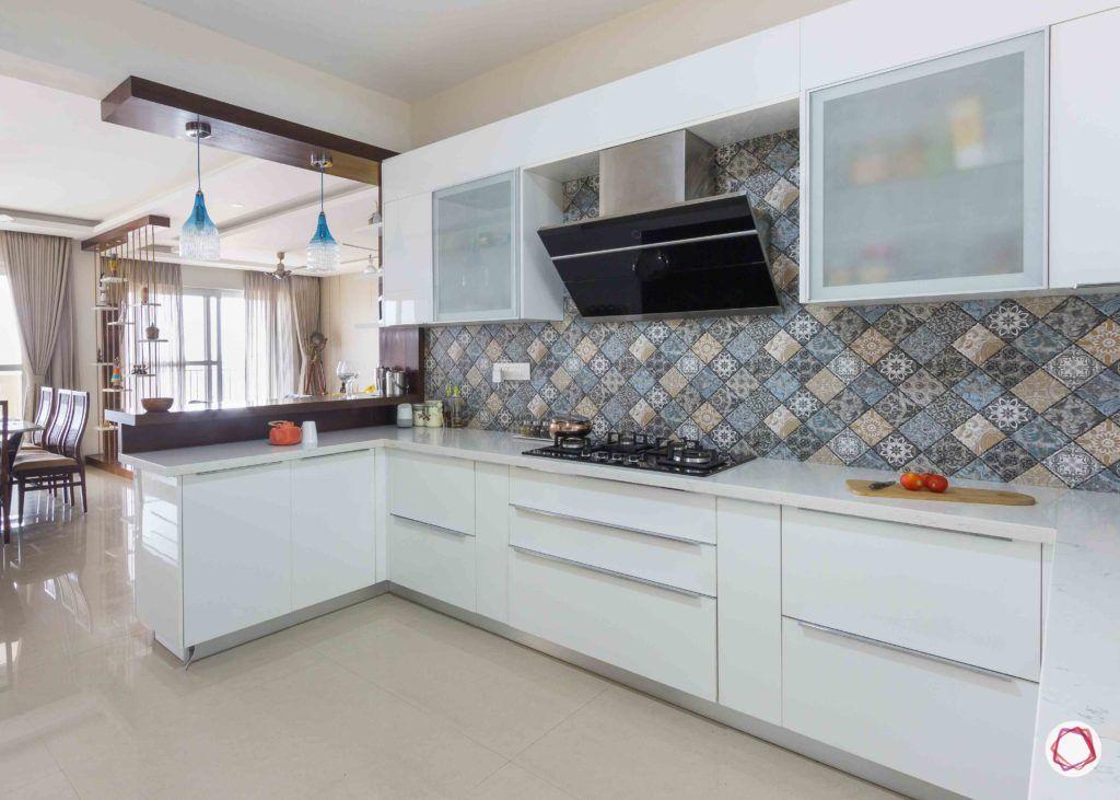 membrane vs laminate-white-glass-cabinets-stove-lights-breakfast-table