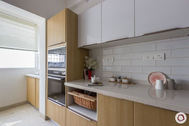 membrane vs laminate-white-upper-yellow-lower-cabinets-brown-tiles-kitchen