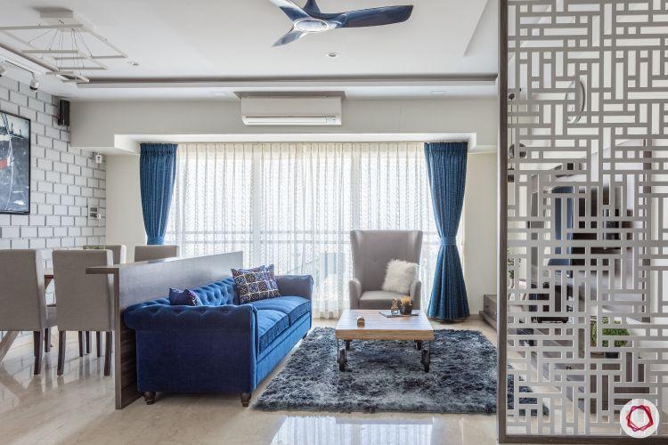 home mumbai-jaali partition designs-blue sofa designs-area rug designs