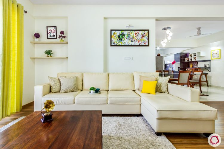 top-interior-designers-in-bangalore-living-room-beige-sofa-wooden-table