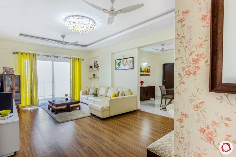 top-interior-designers-in-bangalore-living-room-wooden-flooring-sofa-curtain
