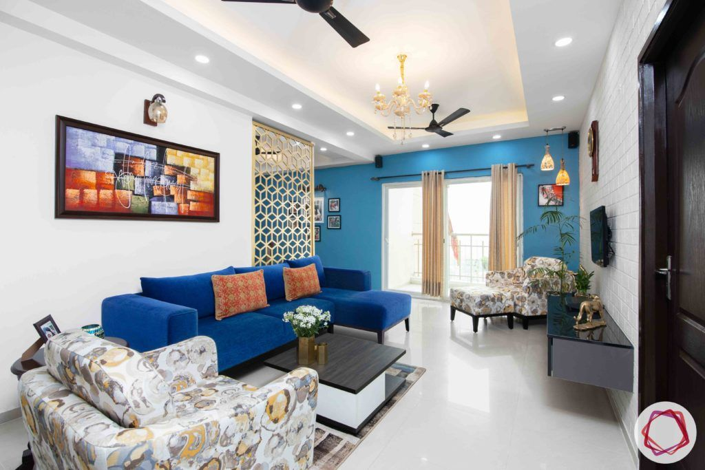 3bhk flat interior design-blue sofa design-l-shaped sofa designs-jaali partition designs
