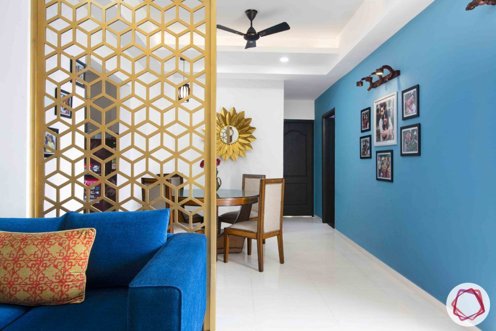 3bhk flat interior design-blue gallery wall designs-focus lights for photo frames