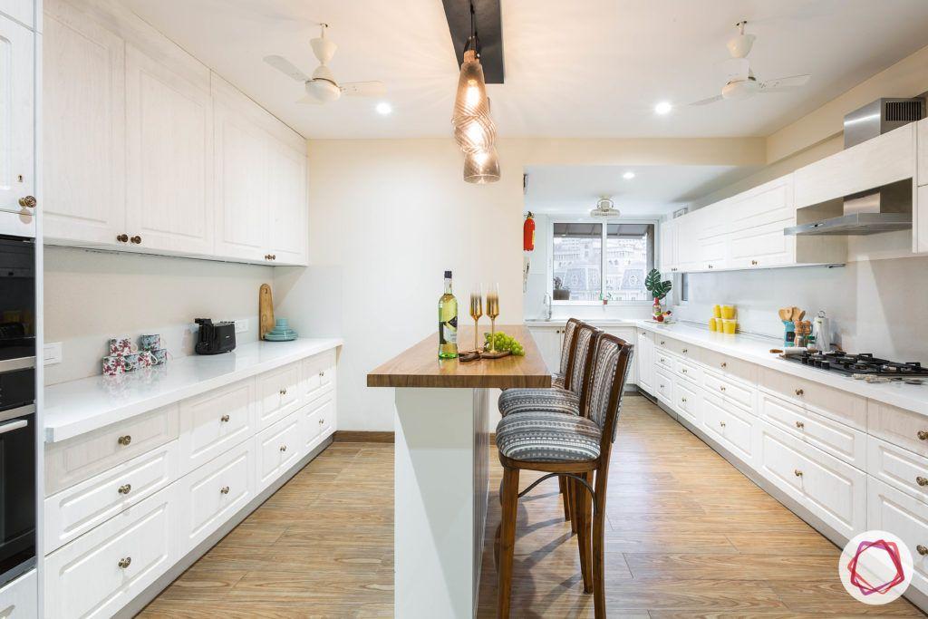 kitchen-for-elderly-wooden-flooring-white-cabinets