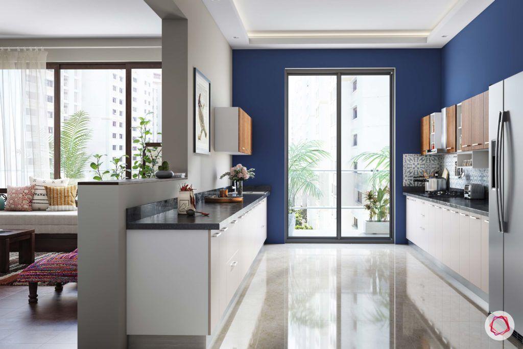 radhika apte_open kitchen-blue walls_natural light