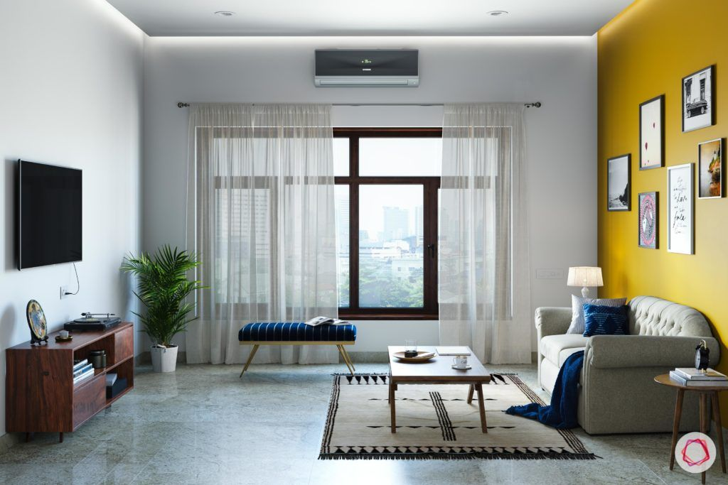 radhika apte-spare-room-TV-curtains-bench-coffee-table-sofa-rug