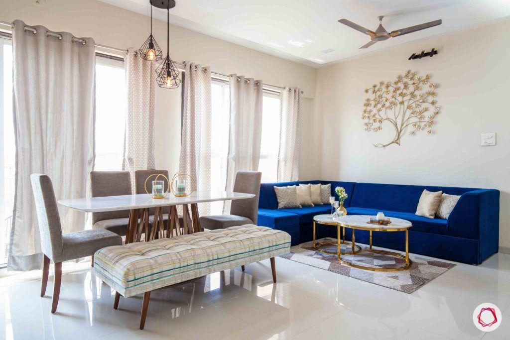 akshar elementa-living room-blue sofa-dining table
