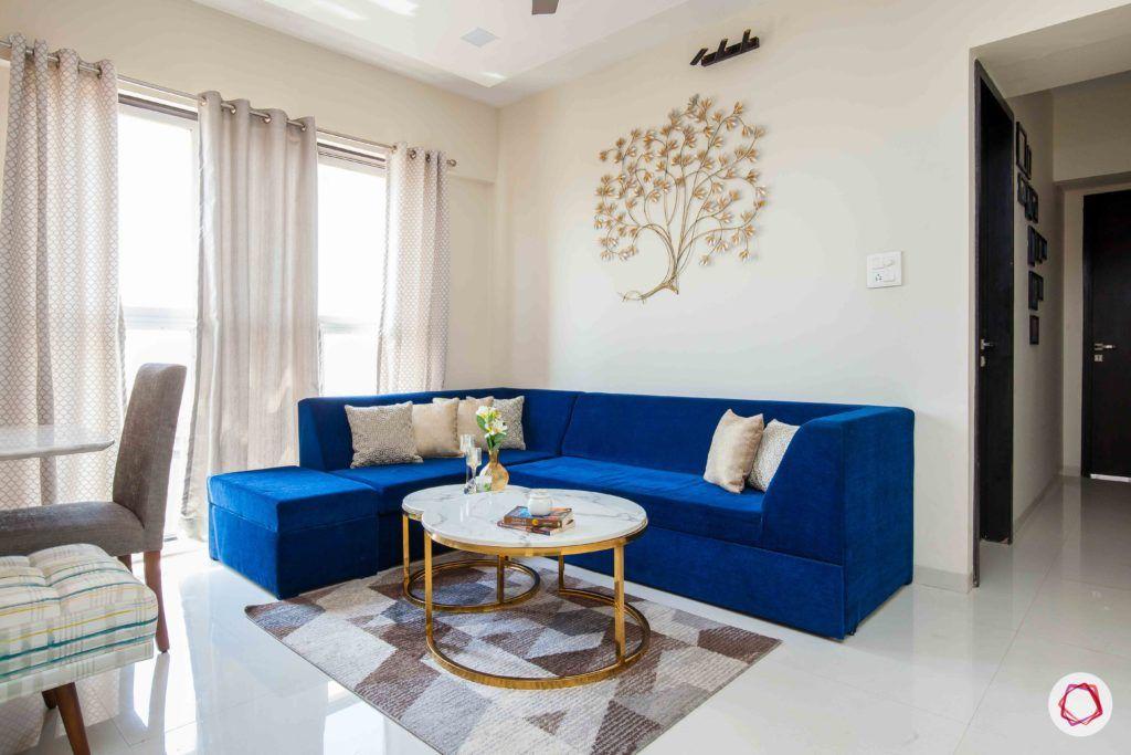 akshar elementa-living room-blue sofa-centre table-wall decor