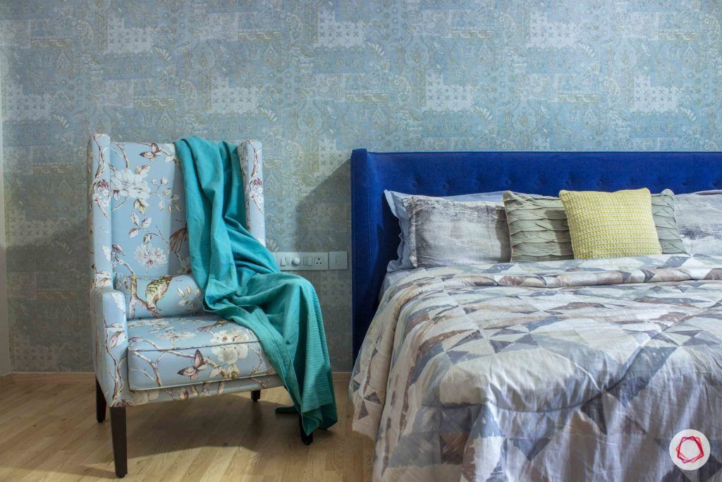 contemporary-house-design-blue-armchair-headboard-wallpaper-bed