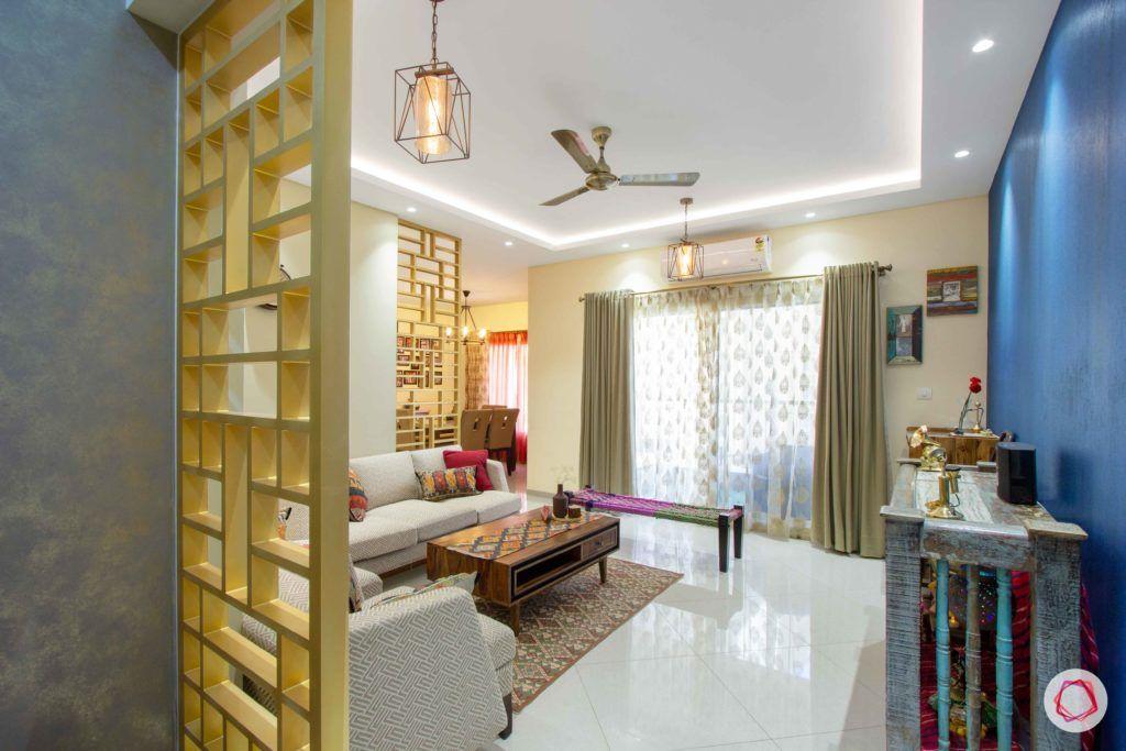 contemporary-house-design-foyer-gold-jali-wallpaper-blue-false-ceiling