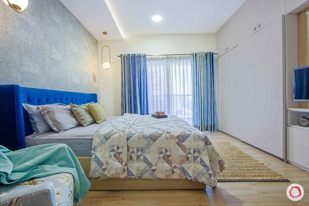 master-bedroom-blue-wallpaper-headboard-wardrobe