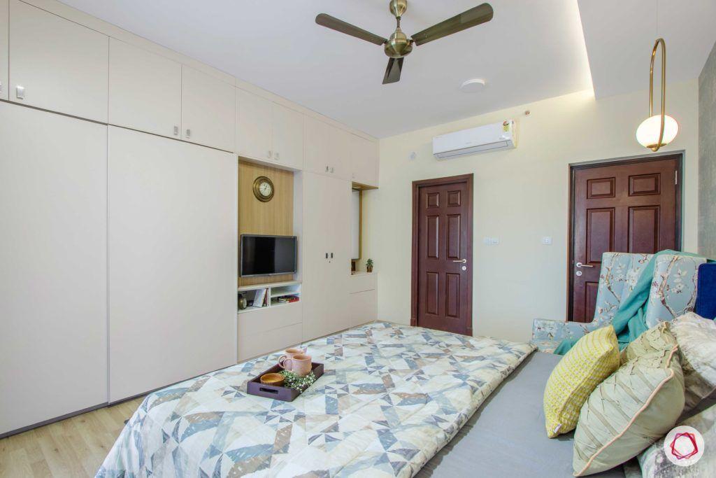 master-bedroom-blue-wallpaper-wardrobe-TV-unit