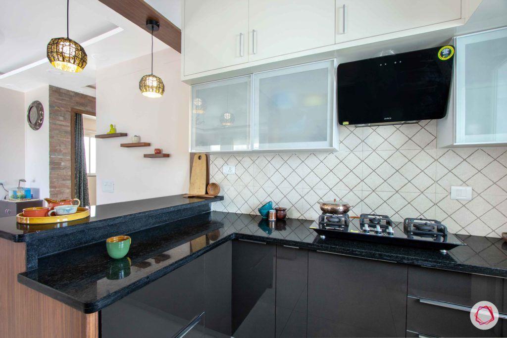 snn raj greenbay-grey kitchen cabinets-black countertop