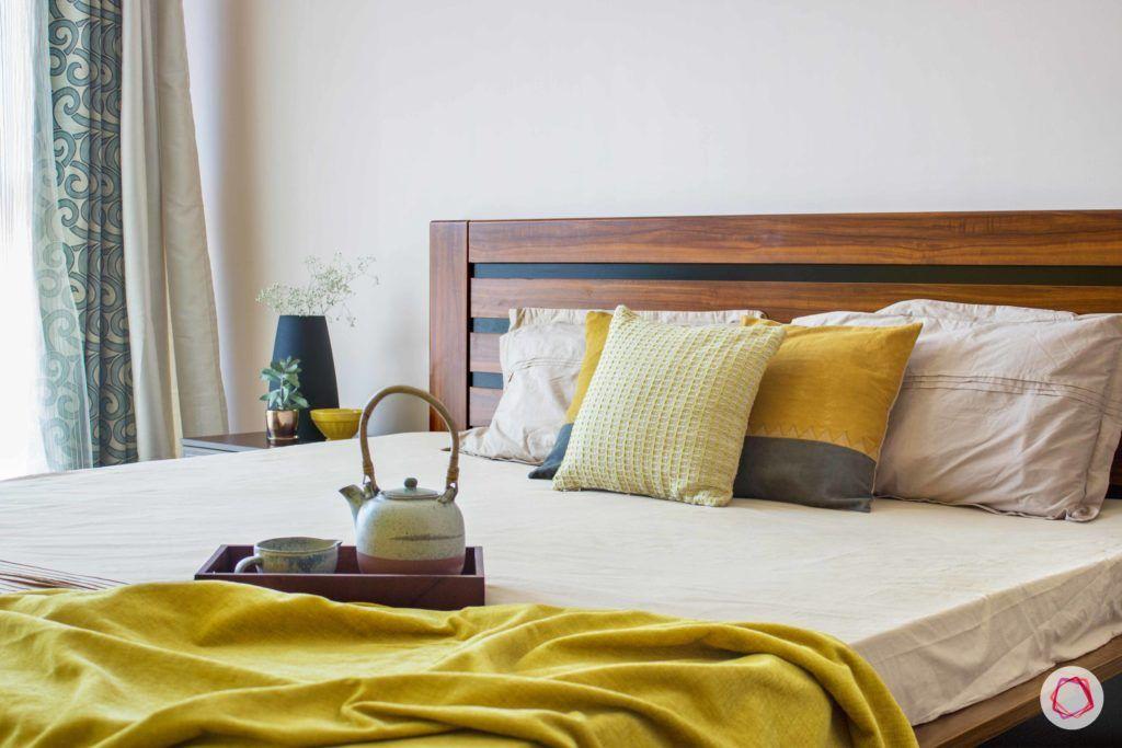 snn raj greenbay-master bedroom-yellow throw-wooden bed-cushions