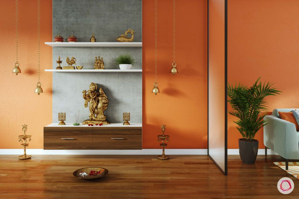 simple pooja mandir designs for walls_glass screen_divider_pooja unit in living room_orange walls_display shelves