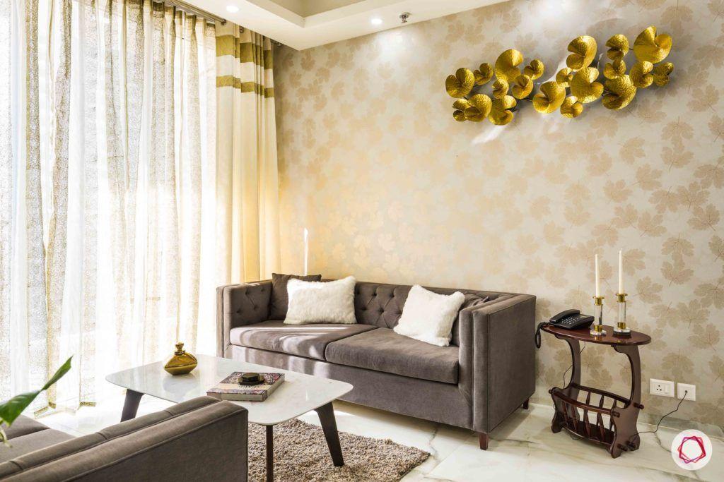 Nirala-Aspire-living-room-grey-sofa-gold-accent-curtains-coffee-table