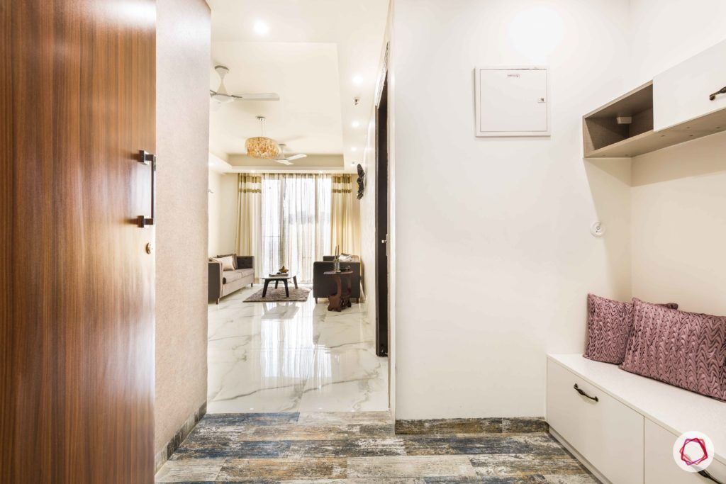 Nirala-Aspire-foyer-shoe-cabinet-white-door-colourful-tiles-floor