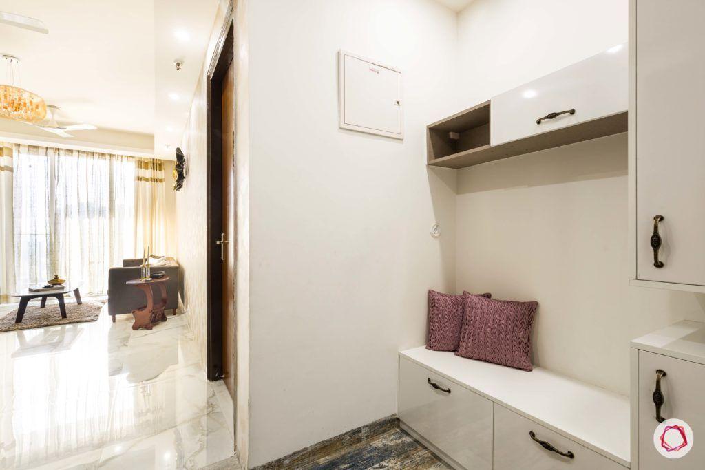 Nirala-Aspire-foyer-shoe-cabinet-white-handles-pillows