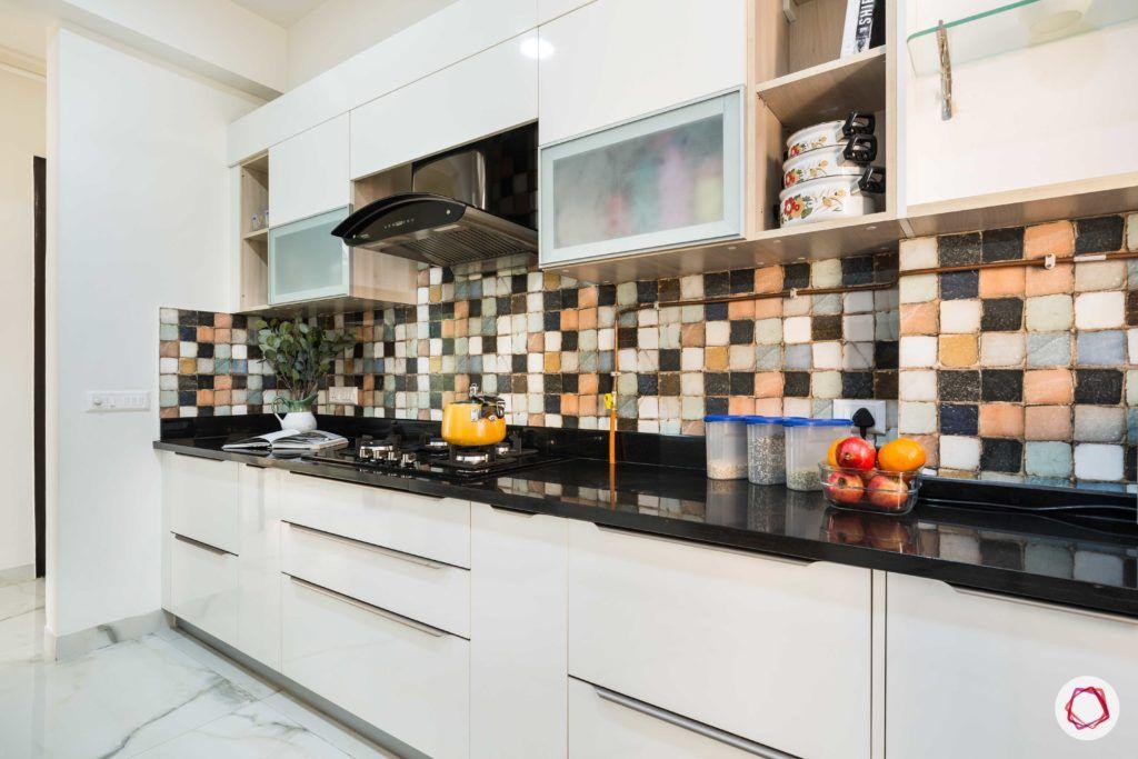 Nirala-Aspire-white-kitchen-cabinets-drawers-chimney