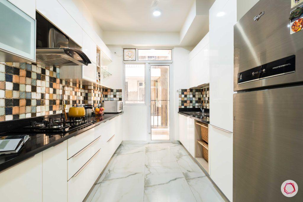 Nirala-Aspire-white-kitchen-cabinets-drawers-fridge