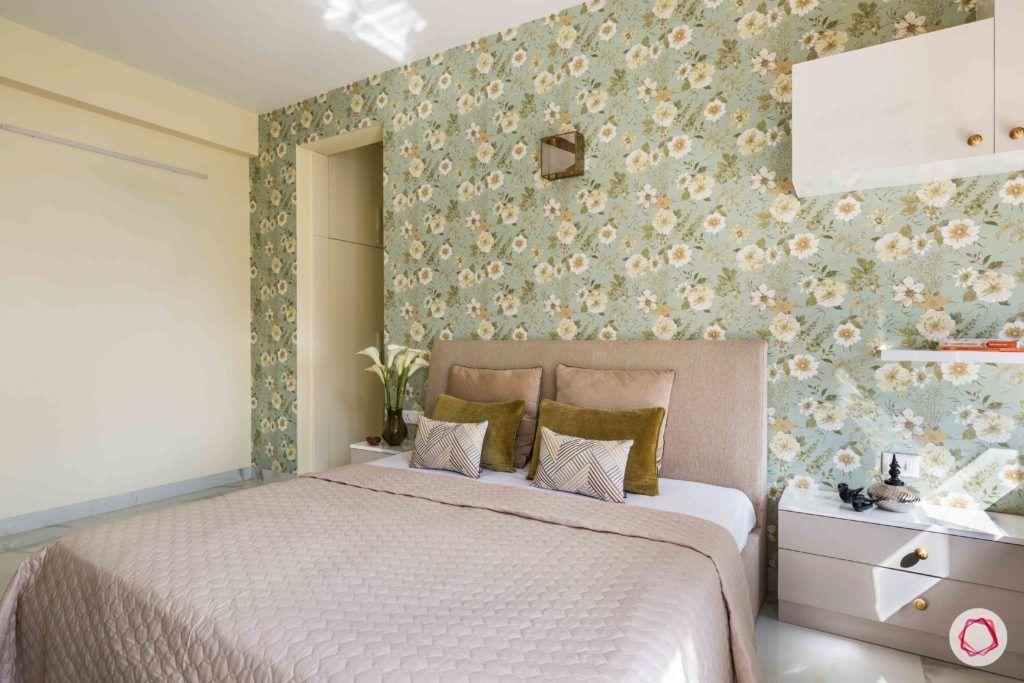 master-bedroom-floral-wallpaper-headboard-pillows-bed-sidetable