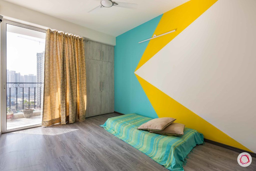 spare-bedroom-colourful-painted-walls-wardrobe-flooring